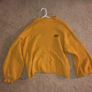 Yellow oversized turtle neck sweater